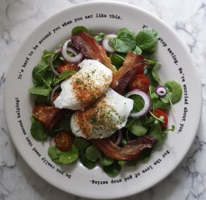 A 'green' Irish breakfast - poached pastured eggs & rashers on a bed of baby watercress